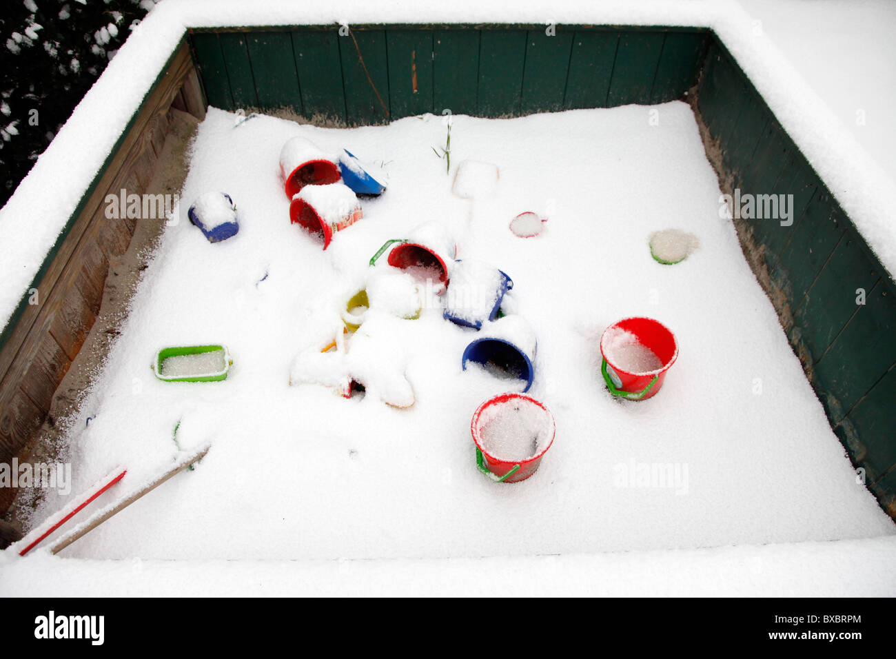 Children's sandbox, toys, covered with snow. - Stock Image