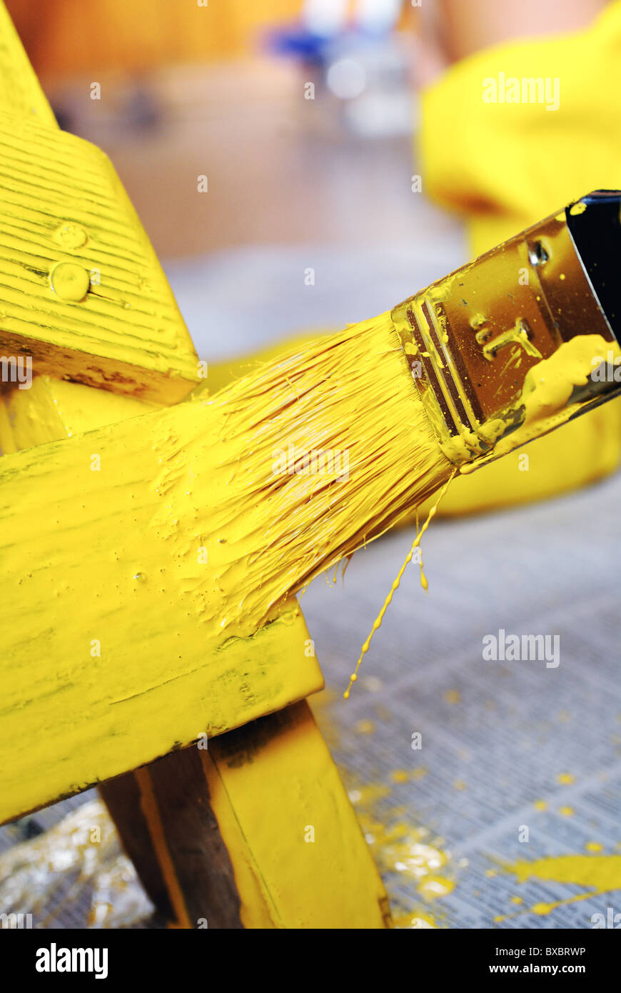 Painting with a paint brush - Stock Image
