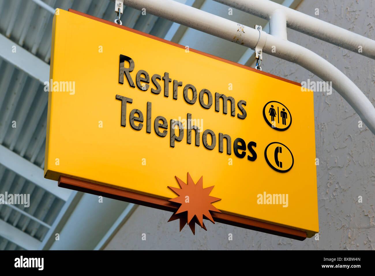 Telephones and Restrooms sign, Orlando Premium Outlets, Lake Buena Vista, Orlando, Florida, USA - Stock Image
