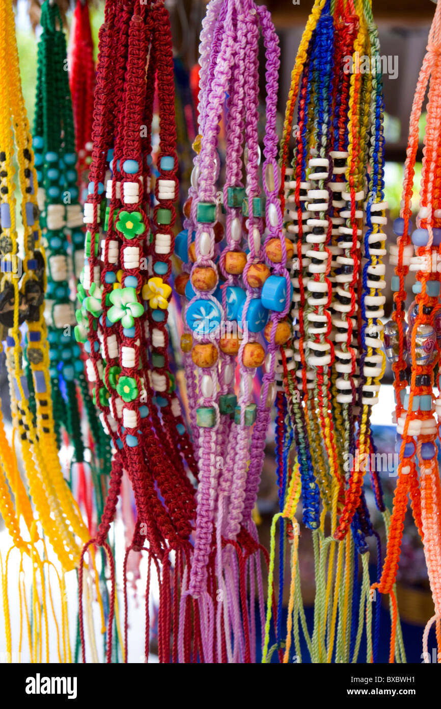 Assortment of colorful mexican hand crafted jewelery for sale at a street market. - Stock Image