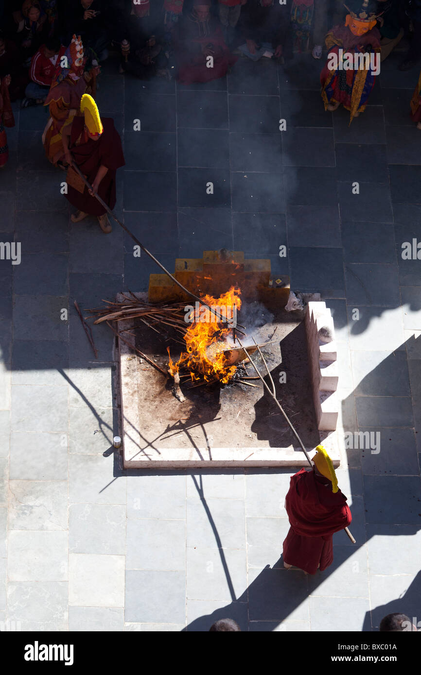 Buddhist monks burning a symbolic picture of the devil during the Thiksey Gustor festival. - Stock Image