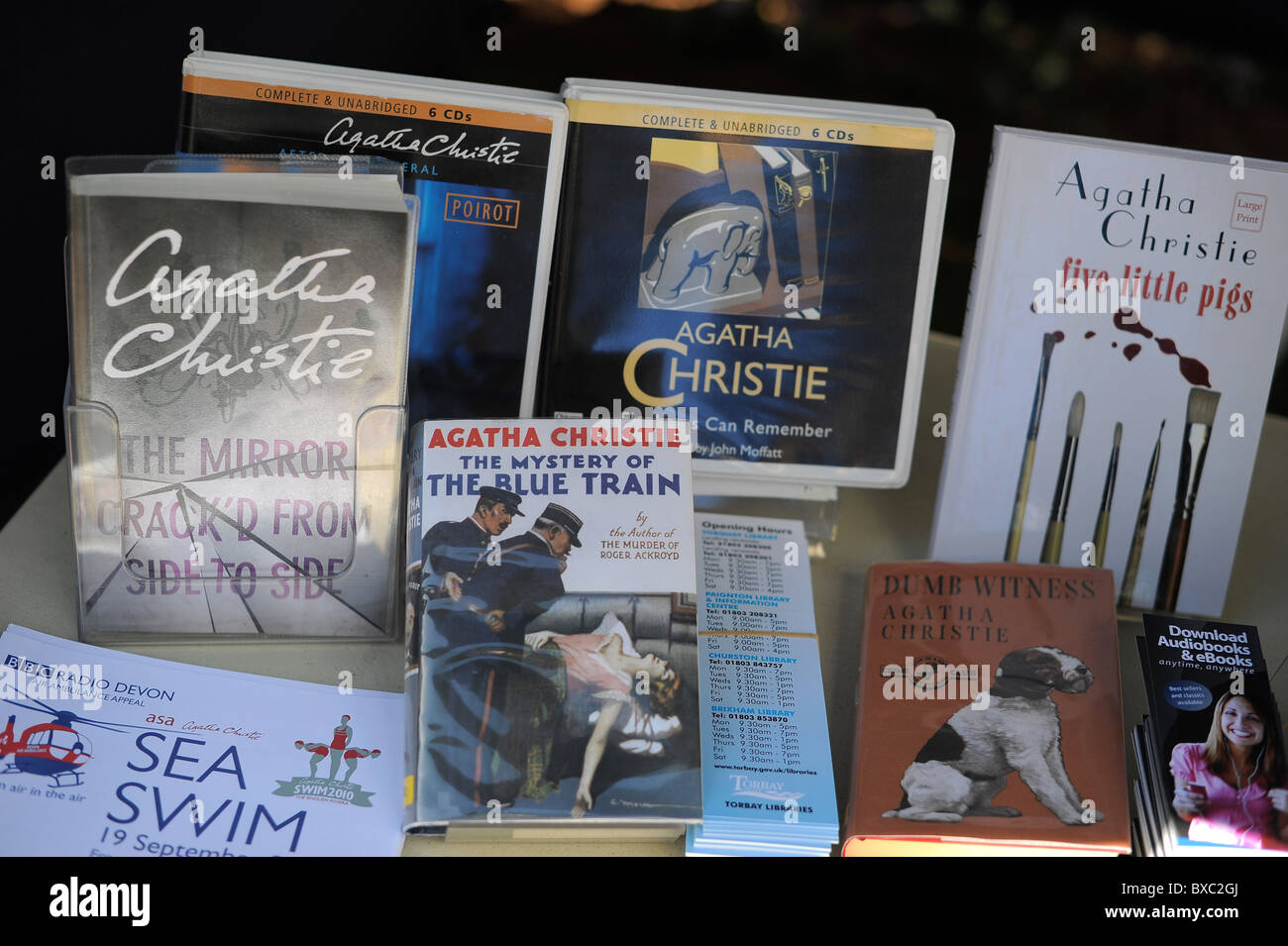 A collection of Agatha Christie books on a table at The Agatha Christie Festival, in Torquay, Devon. - Stock Image