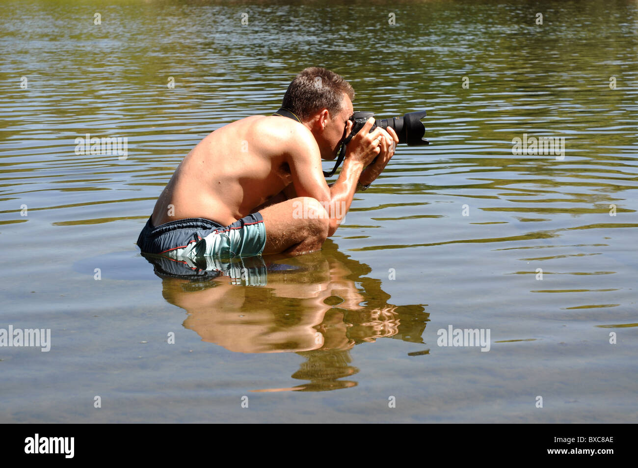 Professional photographer working under extreme conditions - Stock Image