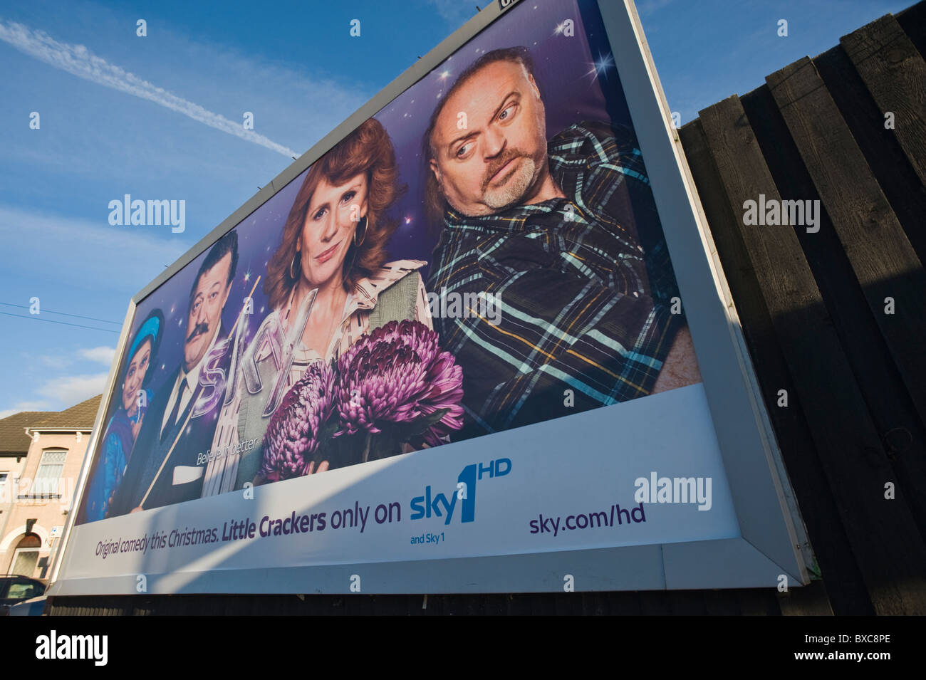 Roadside advertising billboard poster on JCDecaux site for sky1HD television channel Christmas programmes - Stock Image