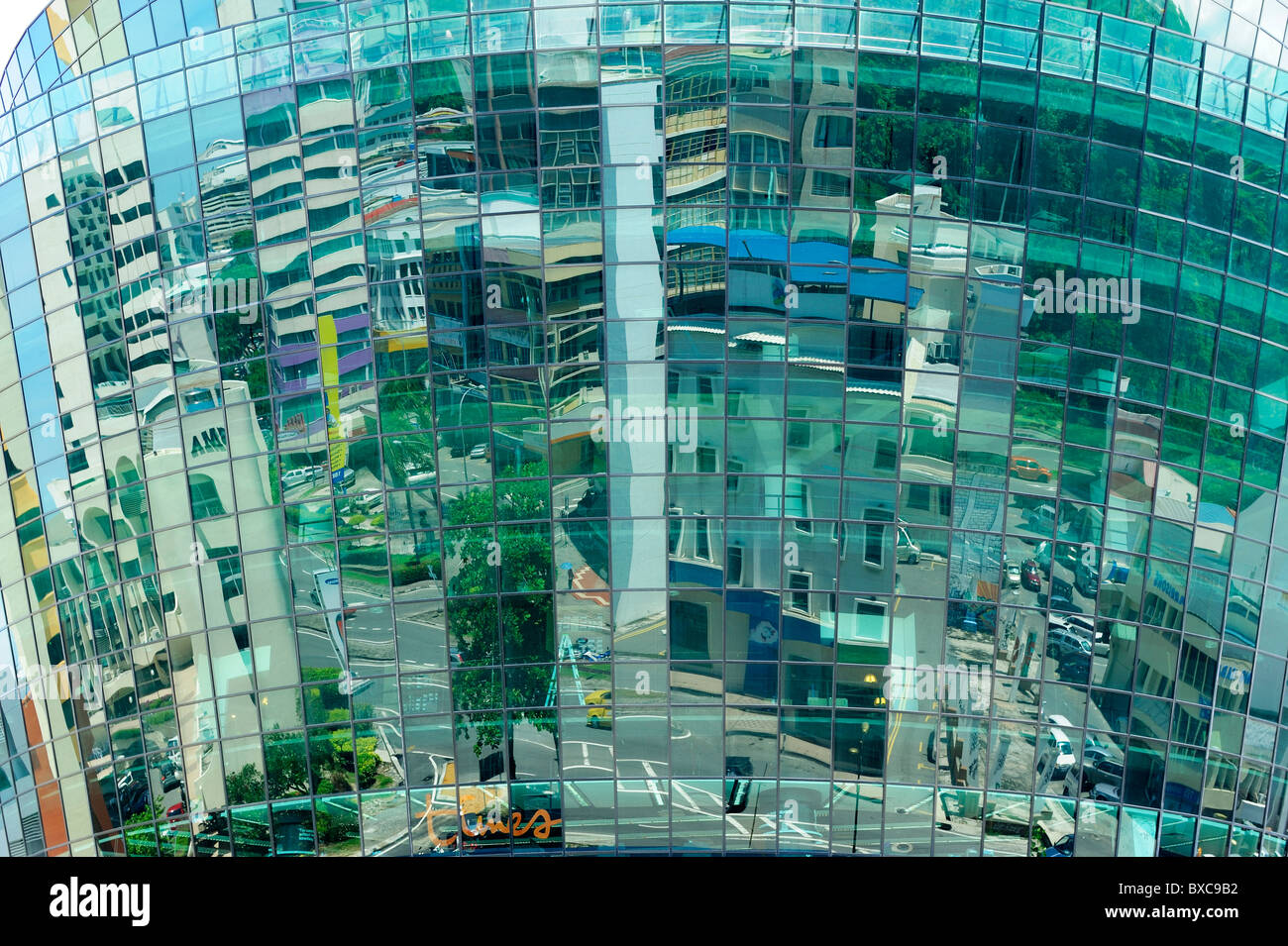 Reflections on glass fronted building in Kota Kinabalu, Sabah - Stock Image