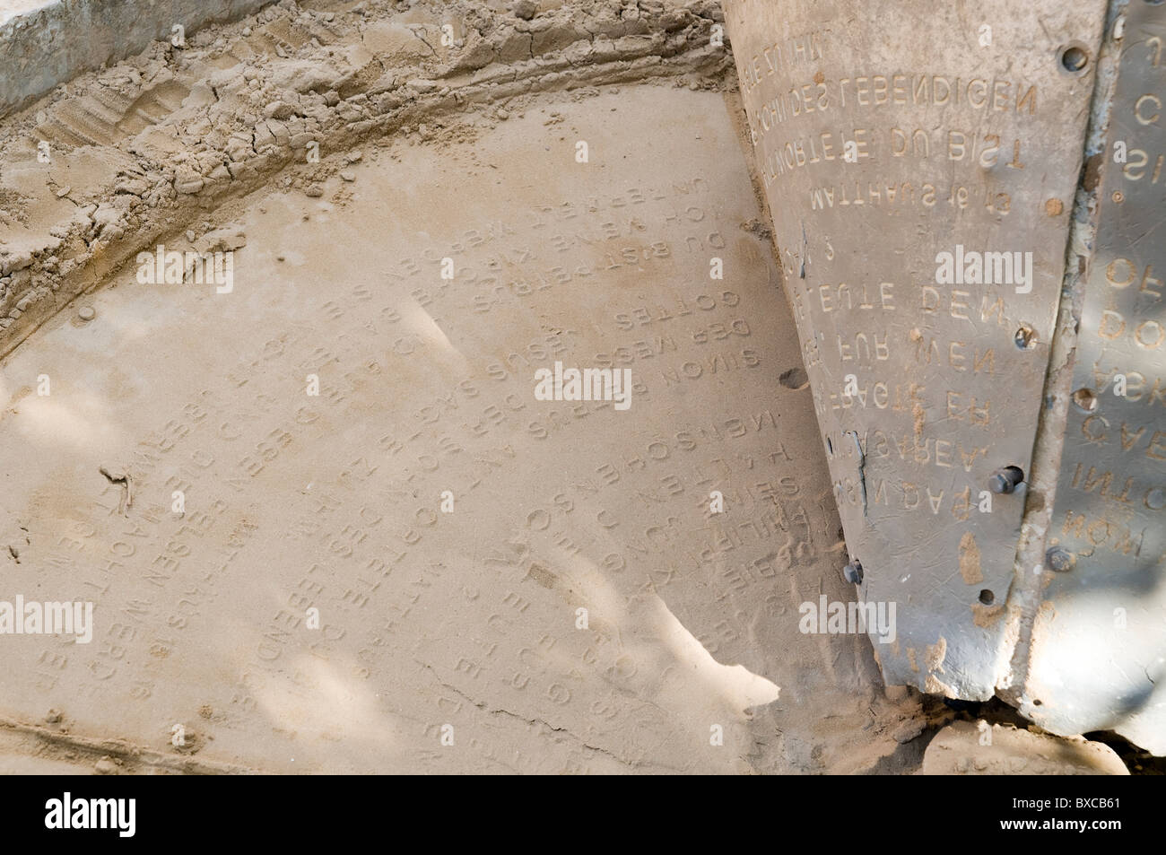 Sand Verses. Versus from the scripture embossed in sand - Stock Image