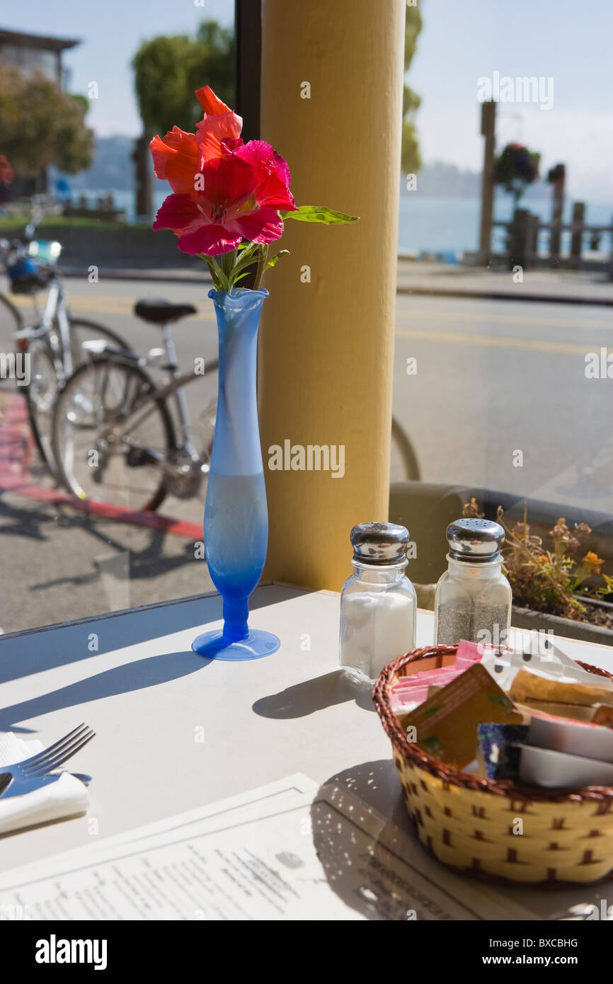 cafe table with menu flower pot basket and salt and pepper shaker sausalito california