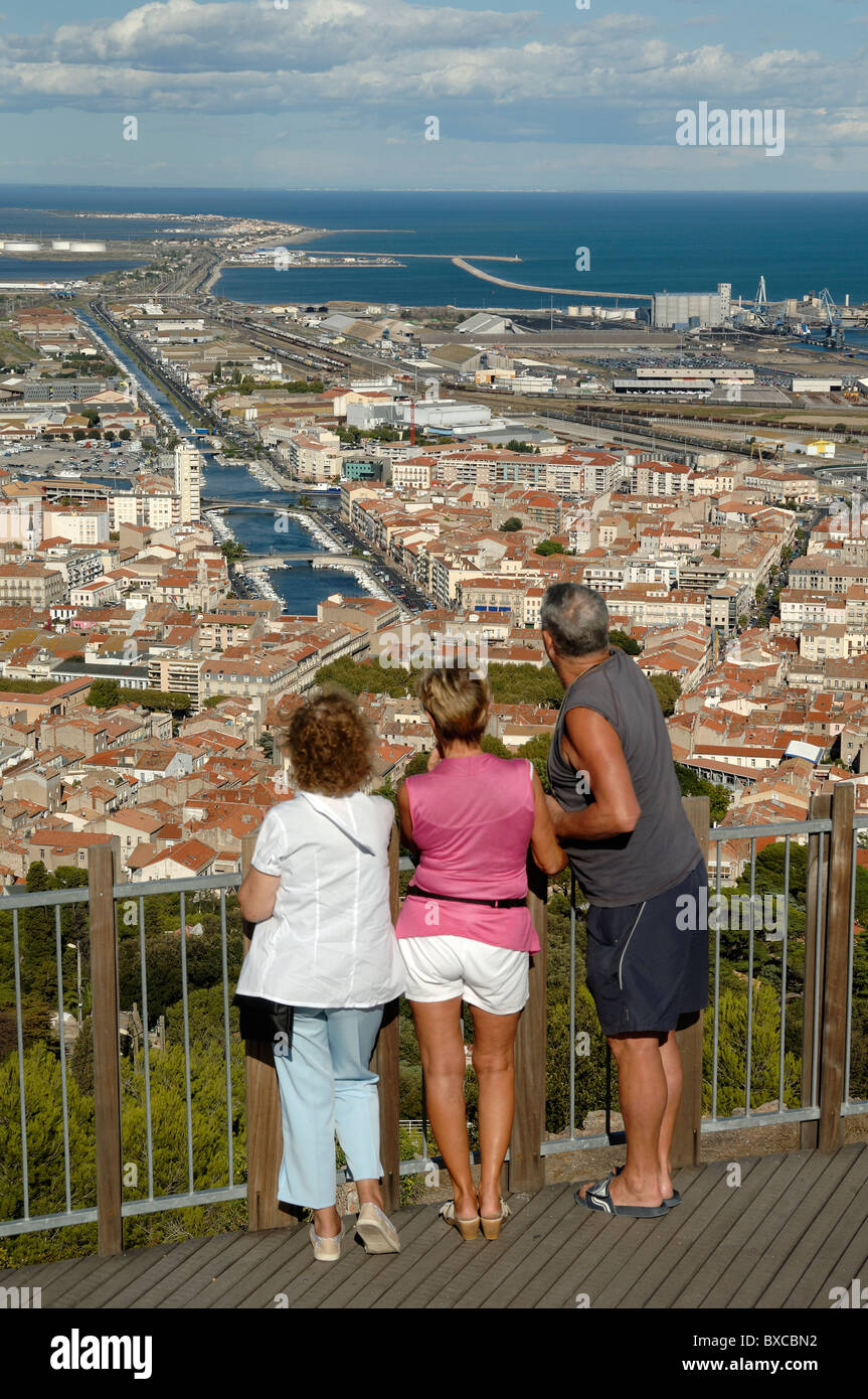 Tourists Admire the View over Sète and the City's Canals from the Mont St-Clair Viewpoint, Sète, France - Stock Image