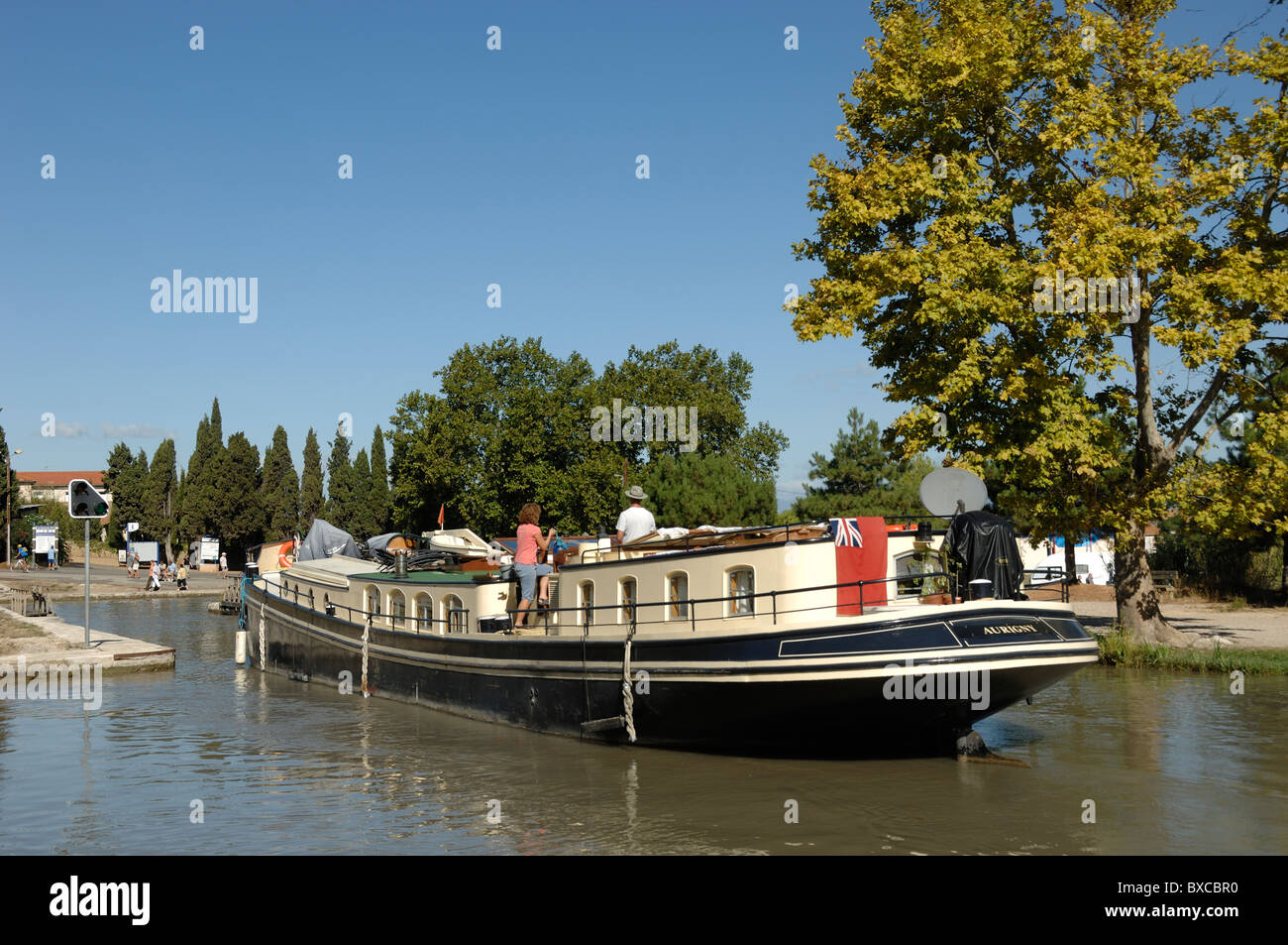 Canal du Midi and Canal Longboat entering Lock System of Fonserannes Lock, or Les Neuf Ecluses, at Beziers, France - Stock Image