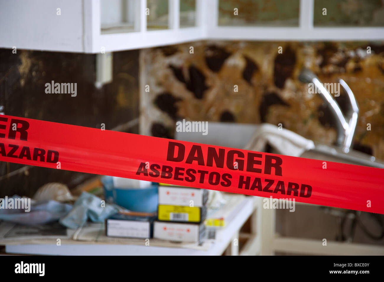 Asbestos Danger In Home - Stock Image