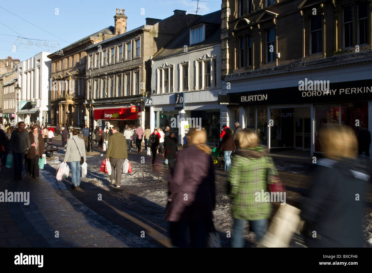 Christmas Shoppers, & crowds or people in the busy urban Main Streets of Dundee City Centre, Tayside,  Scotland, - Stock Image