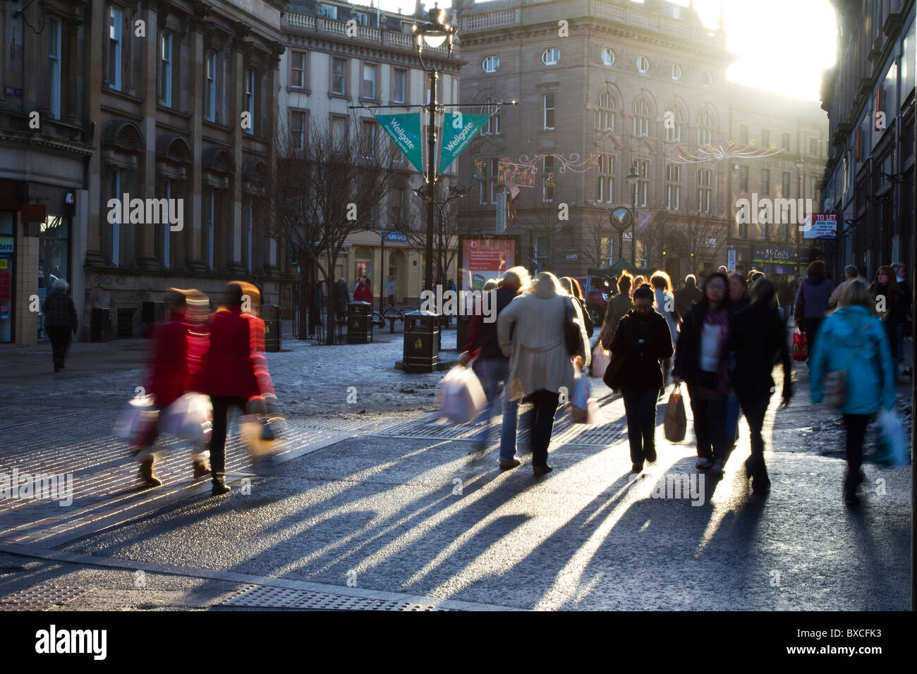 Urban Christmas Shoppers silhouetted in the busy Streets of Dundee, city centre, Tayside, Scotland, UK. People silhouettes - Stock Image