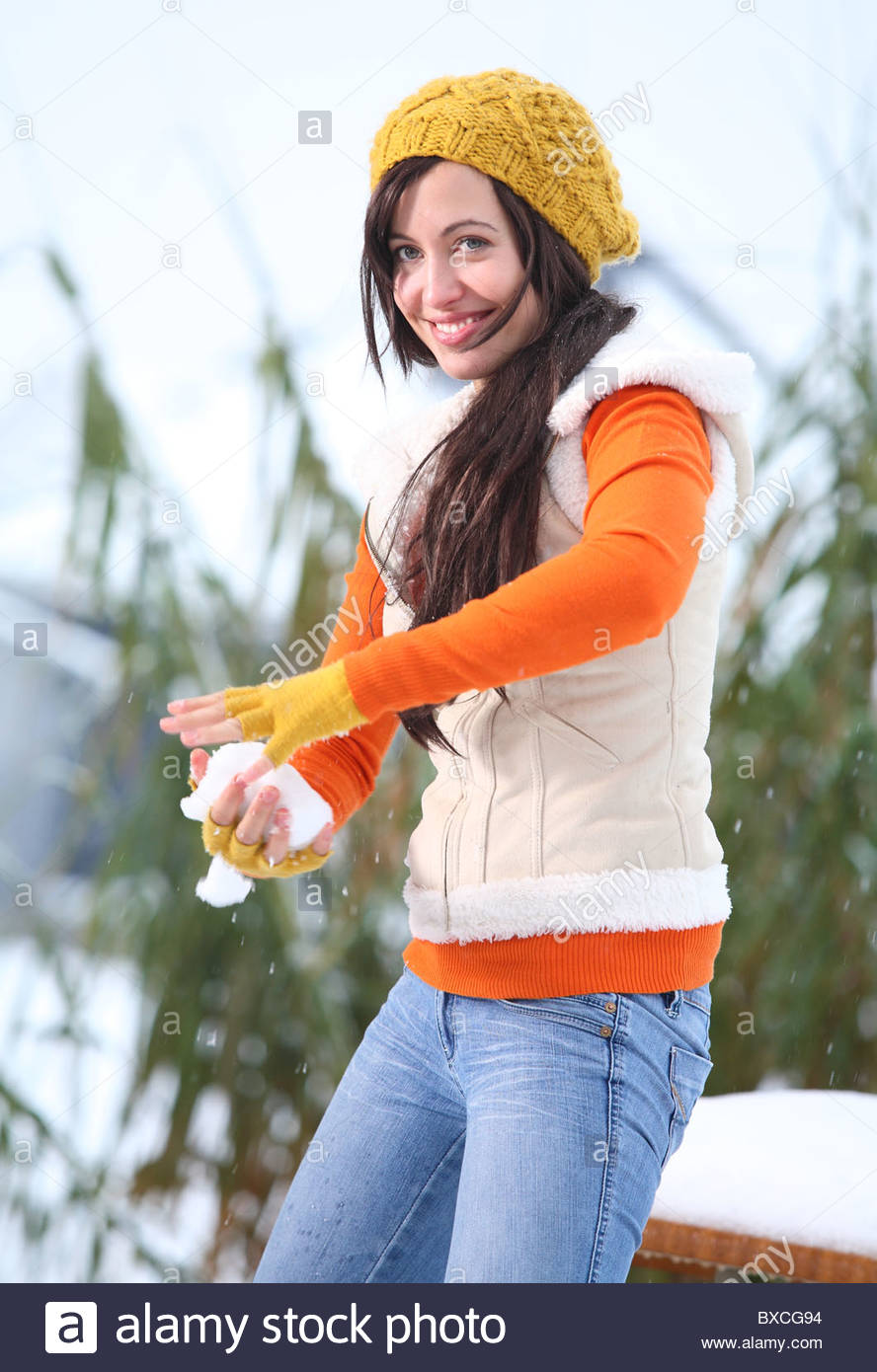 woman throwing snowball Stock Photo