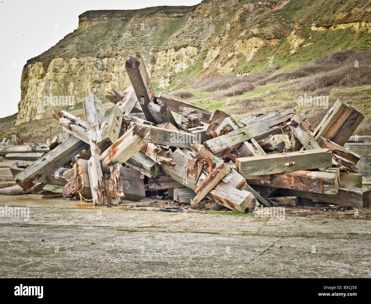Broken wooden breakwaters - Stock Image