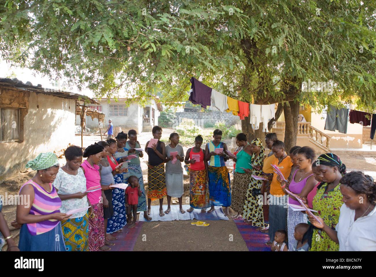 Women attend a community meeting in Freetown, Sierra Leone, West Africa. - Stock Image