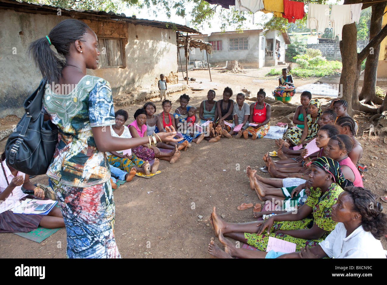 Women attend a community meeting in Freetown, Sierra Leone, West Africa. - Stock Image