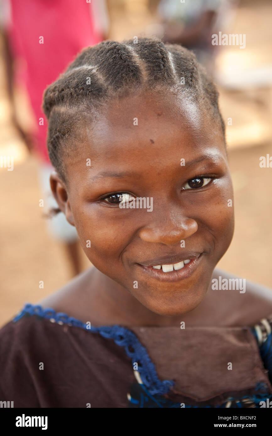 A school girl wears a smile in Freetown, Sierra Leone, West Africa. Stock Photo