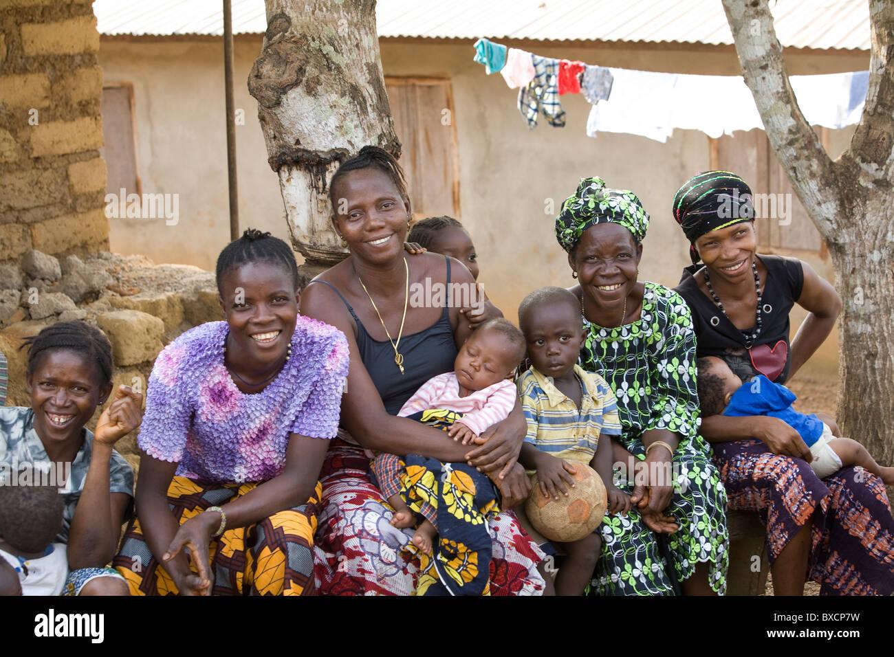 Women gather for a VSLA community meeting in Port Loko, Sierra Leone, West Africa. - Stock Image