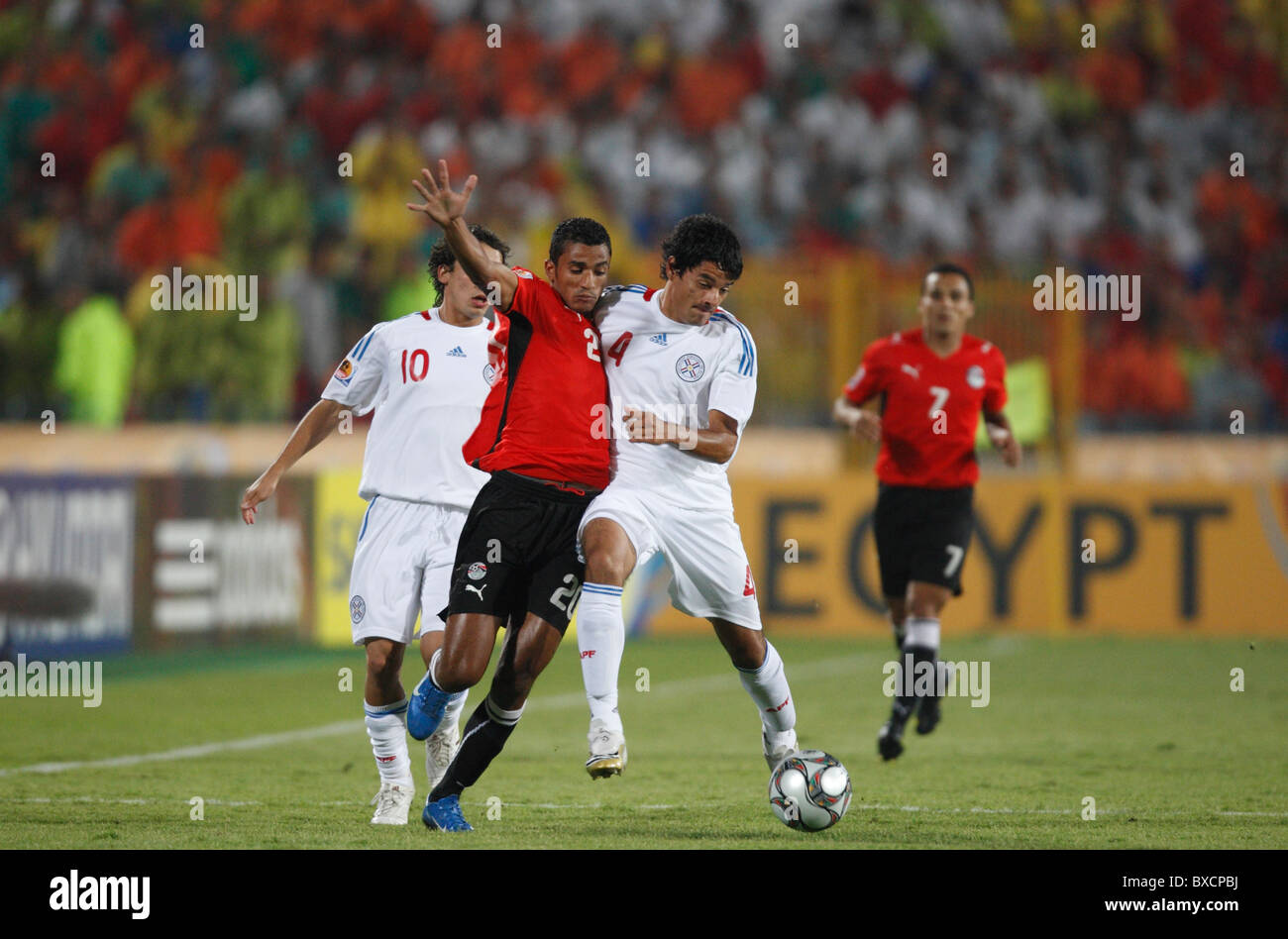 Cesar Benitez of Paraguay (4) takes the ball from Egypt's Hussam Arafat (20) during a 2009 FIFA U-20 World Cup - Stock Image