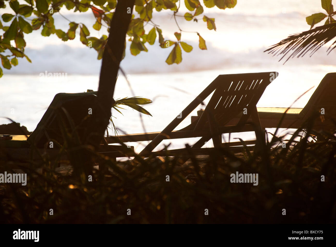 Lounge chairs along Mal Pais coastline in San Jose Costa Rica - Stock Image