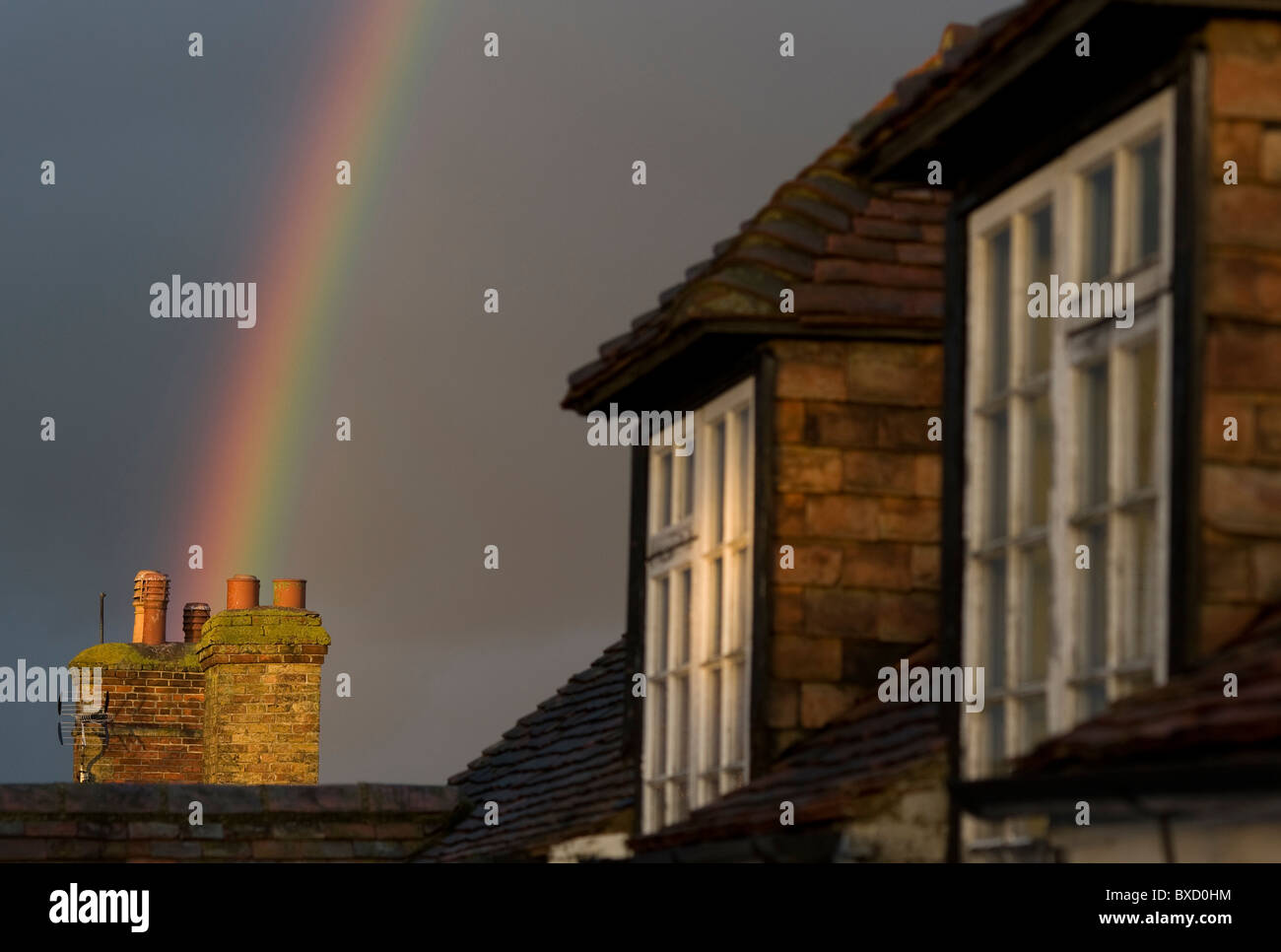 Chimney pots at the end of the rainbow, Wingham, Kent, 16th December 2010.  - Stock Image