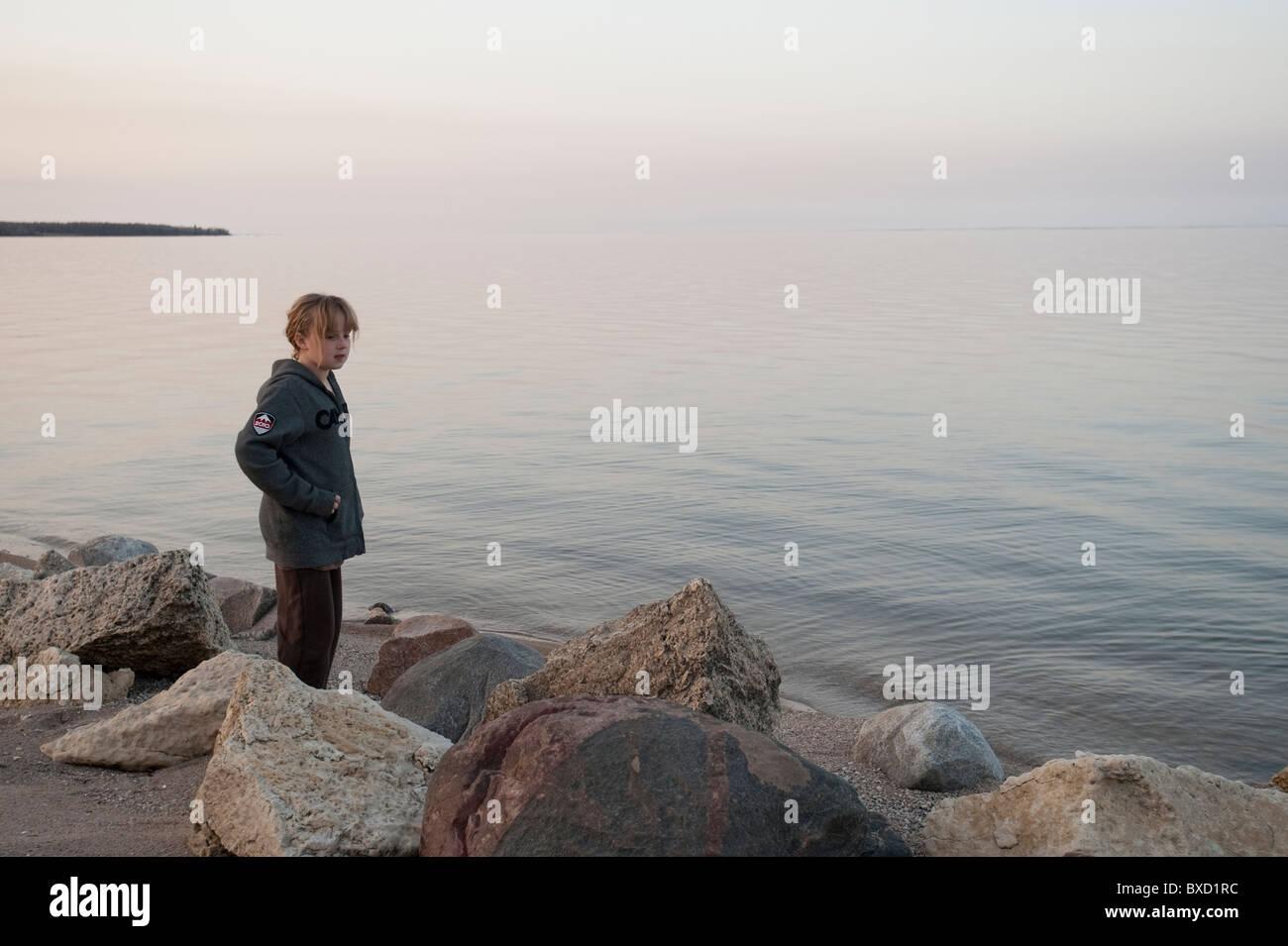 Girl along the shoreline in Gimli, Manitoba, Canada Stock