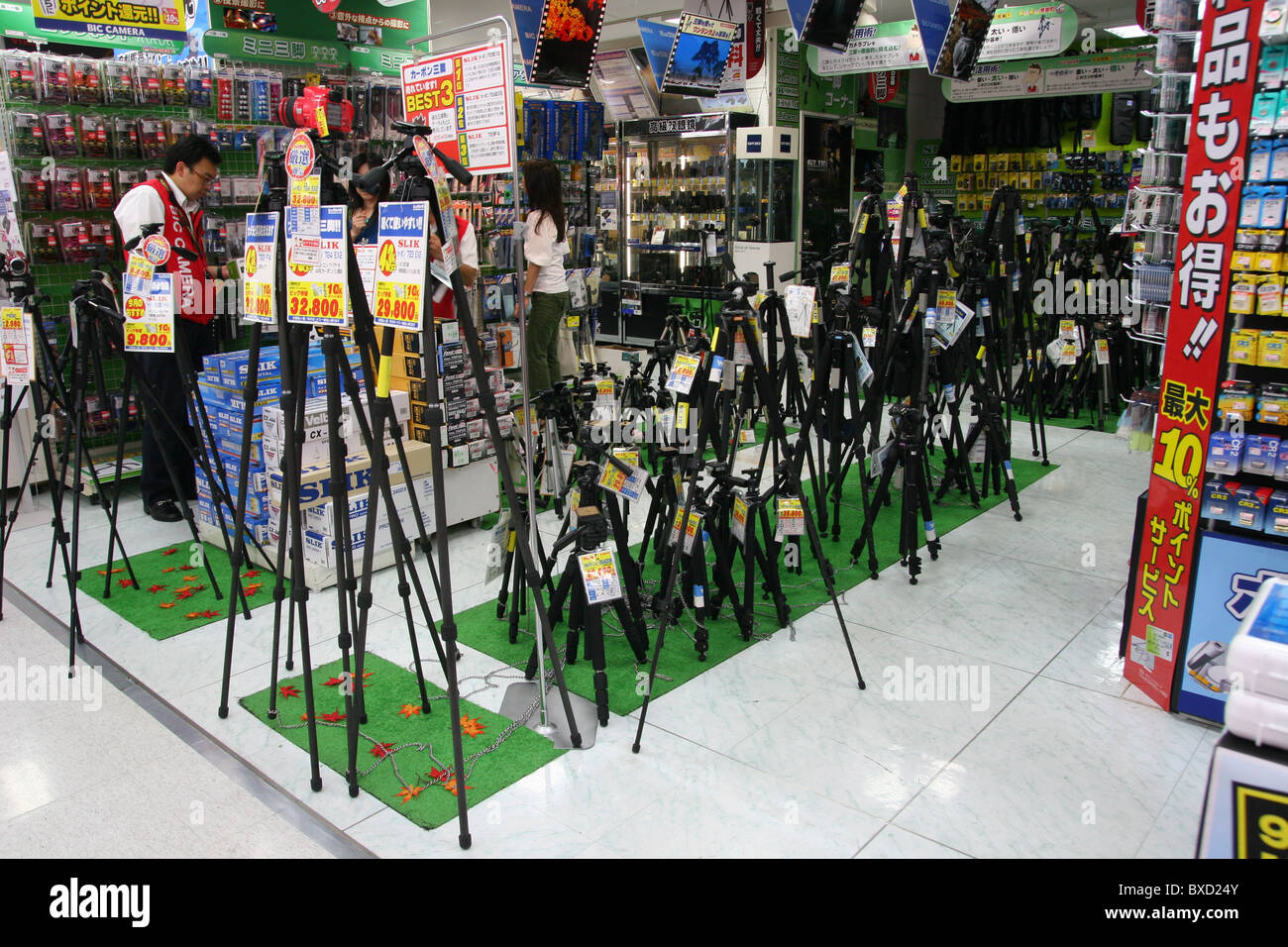 Various camera tripods for sale in Bic camera store in Tokyo Japan 2010 - Stock Image