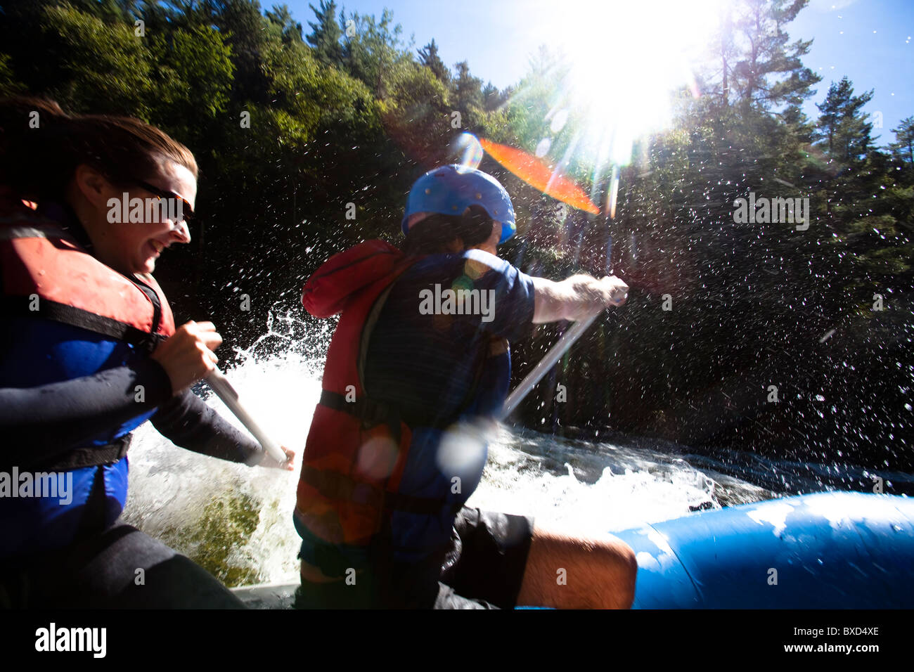 A group of adults whitewater rafting in Maine Stock Photo