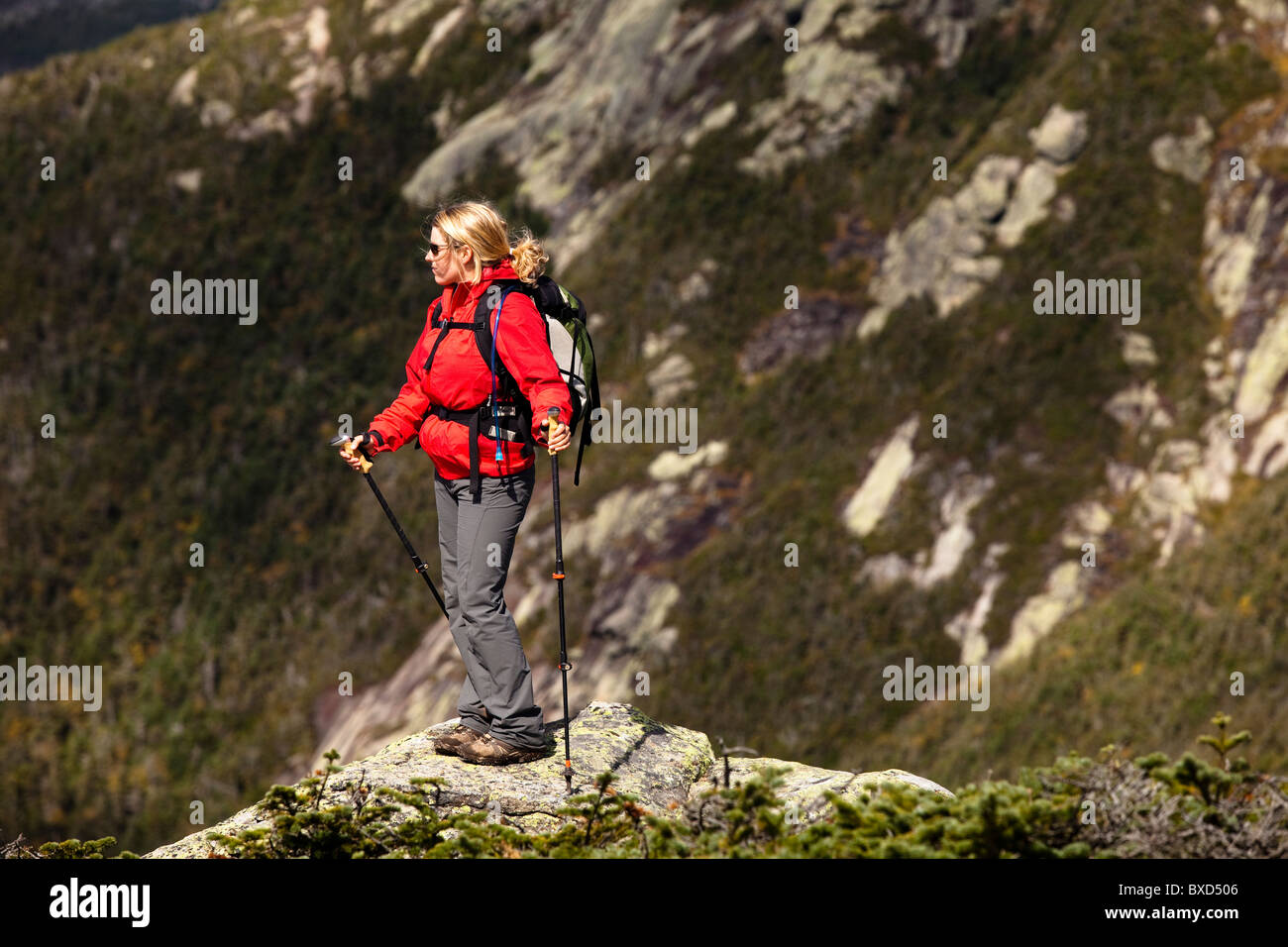 An athletic female hiker hikes the Franconia Ridge Trail. - Stock Image