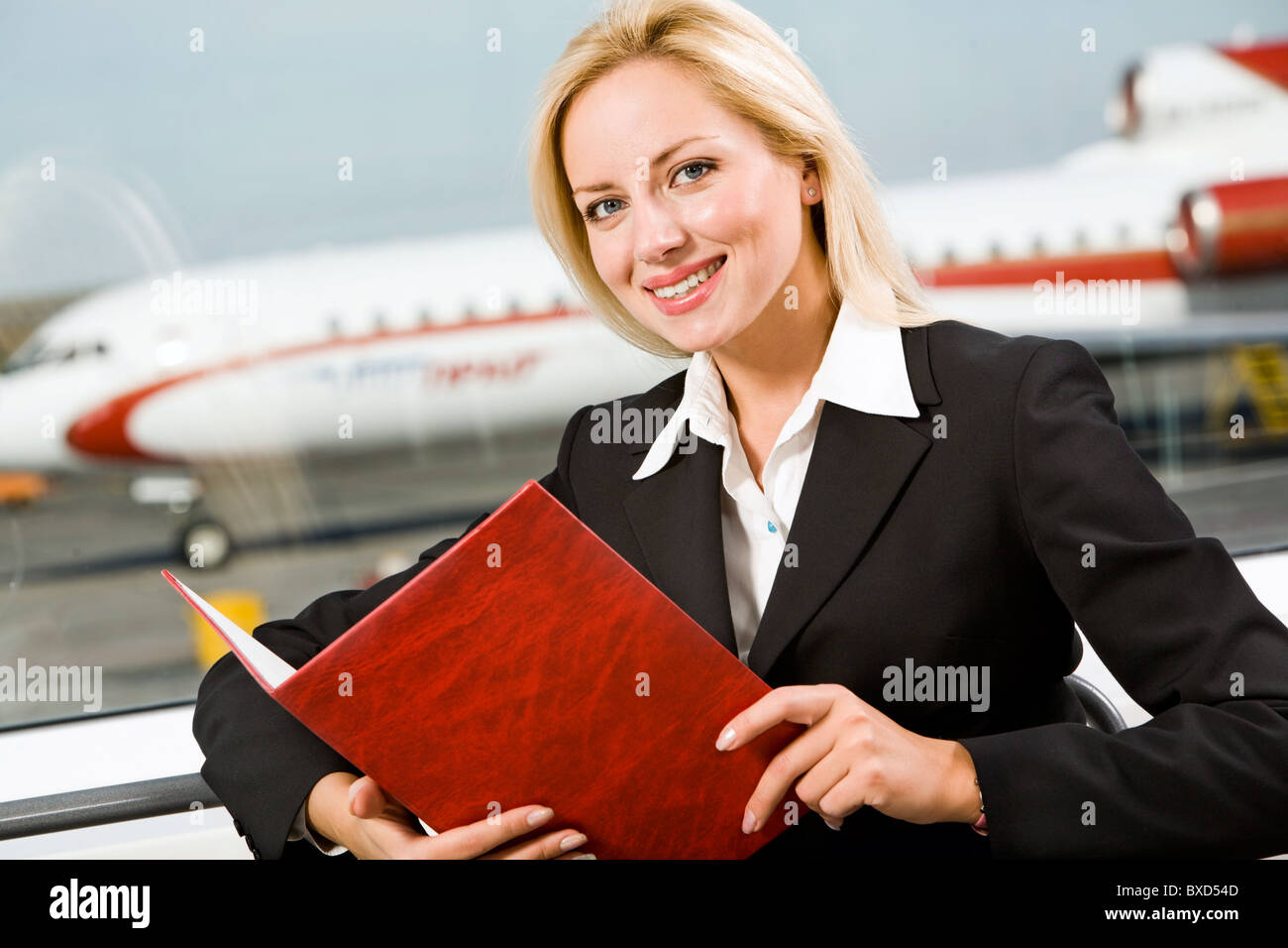 Portrait of highly skilled worker holding the red folder Stock Photo