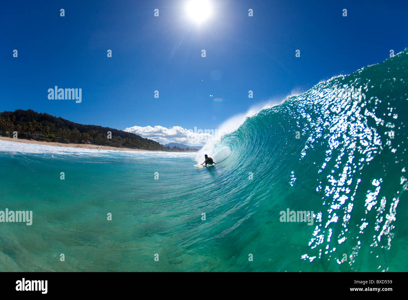 A water view of a surfer getting barreled at Pupukea Sandbar. - Stock Image
