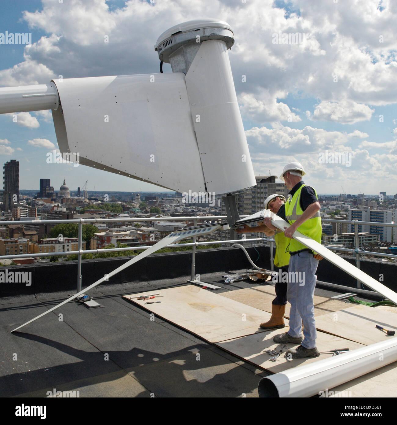erecting a wind turbine on a roof of a housing block of flats city road london uk - Roof Turbine