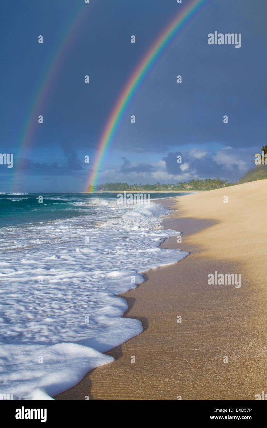 An amazing double rainbow over Rocky Point, on the north shore of Oahu, Hawaii. Stock Photo