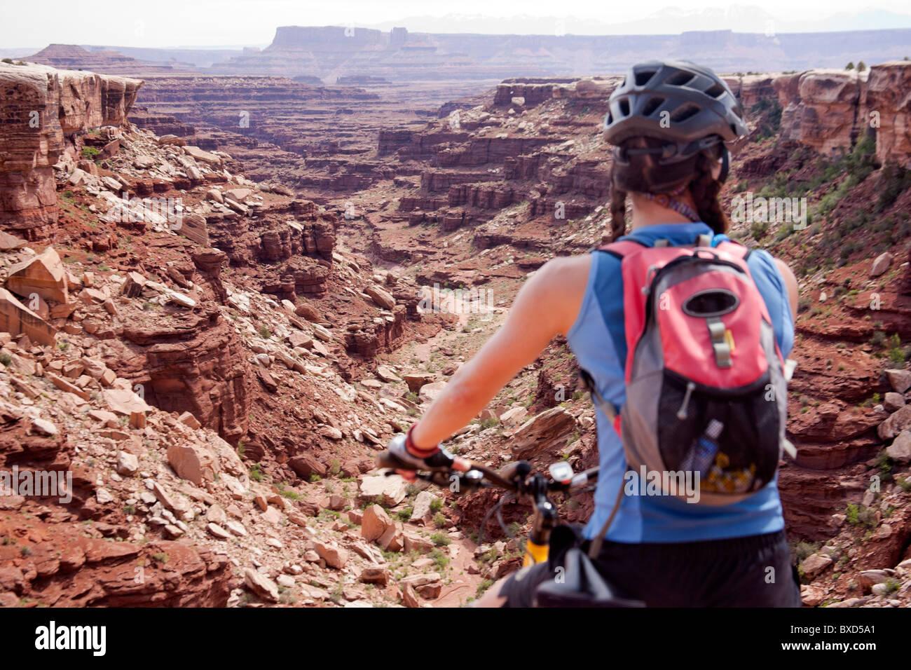 A woman bikes the White Rim trail in Utah. Stock Photo