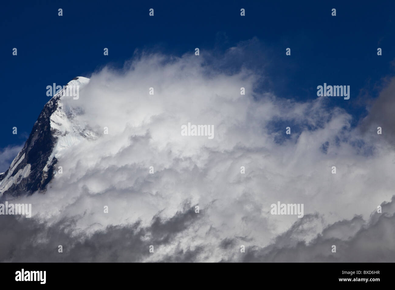 A cloud system builds from the south face of Annapurna South. - Stock Image