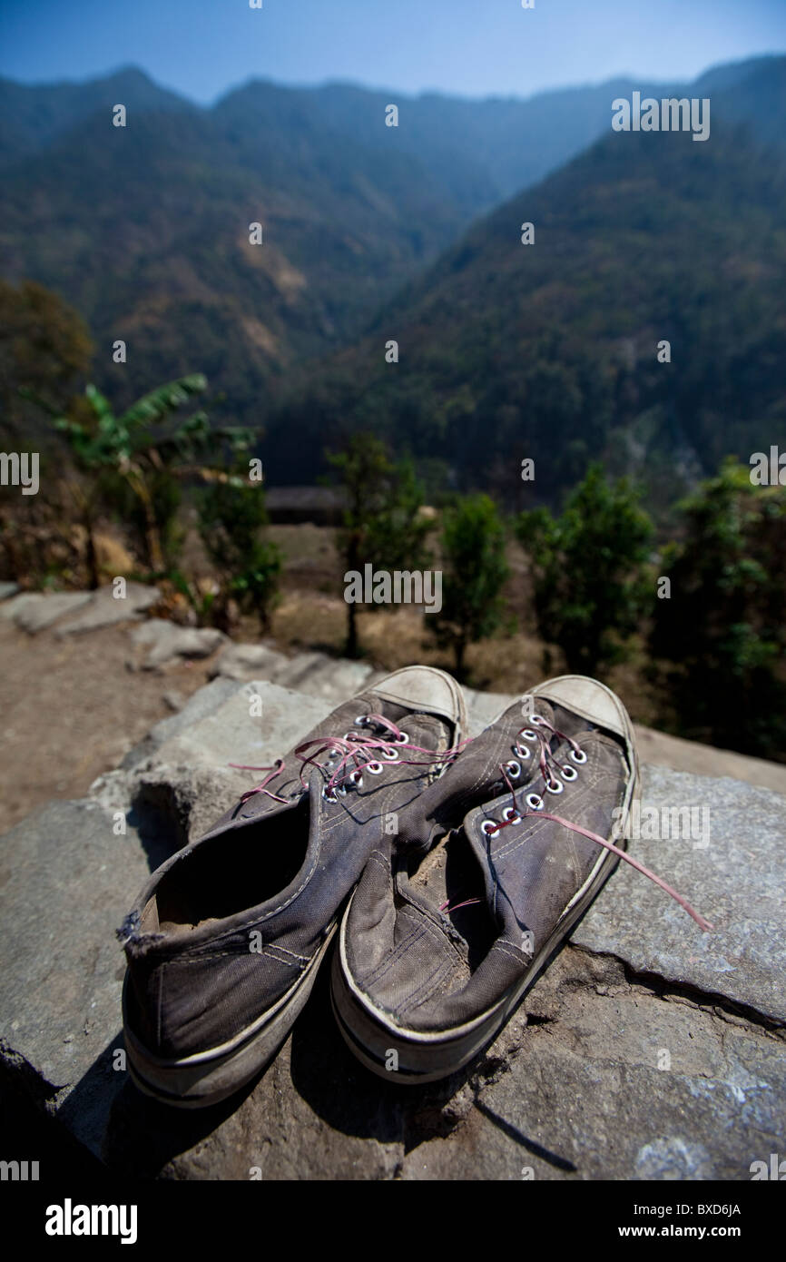 Old shoes point off towards the Himalayan foothills in Nepal. - Stock Image