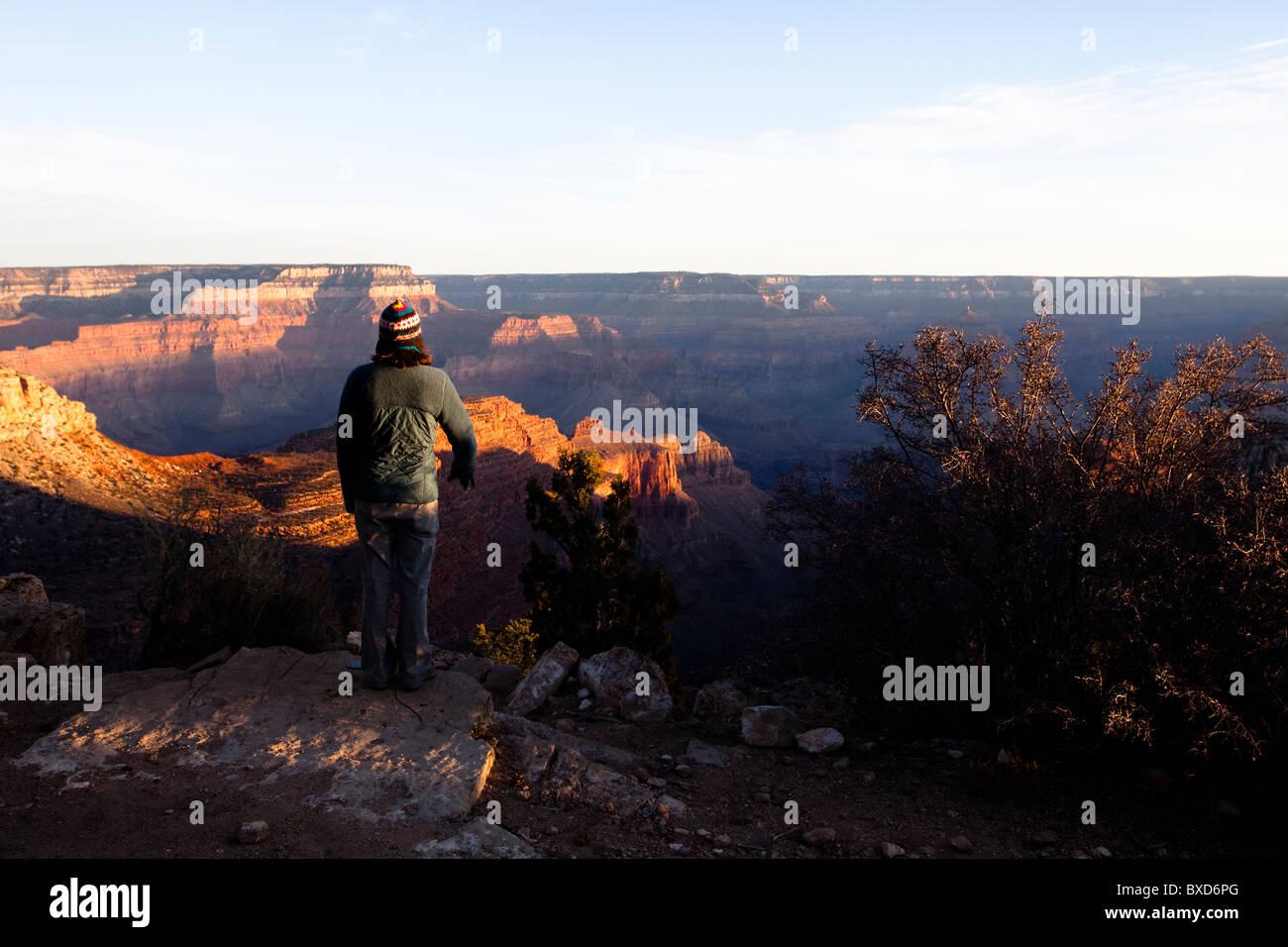 A woman stares at Arizona's Grand Canyons North Rim. - Stock Image