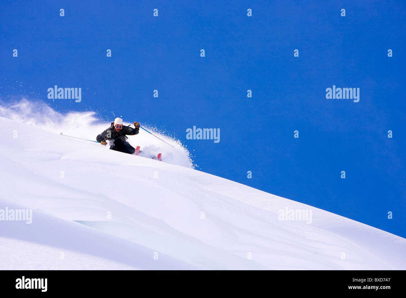A man prepares to catch some air on a sunny day in Austria. - Stock Image