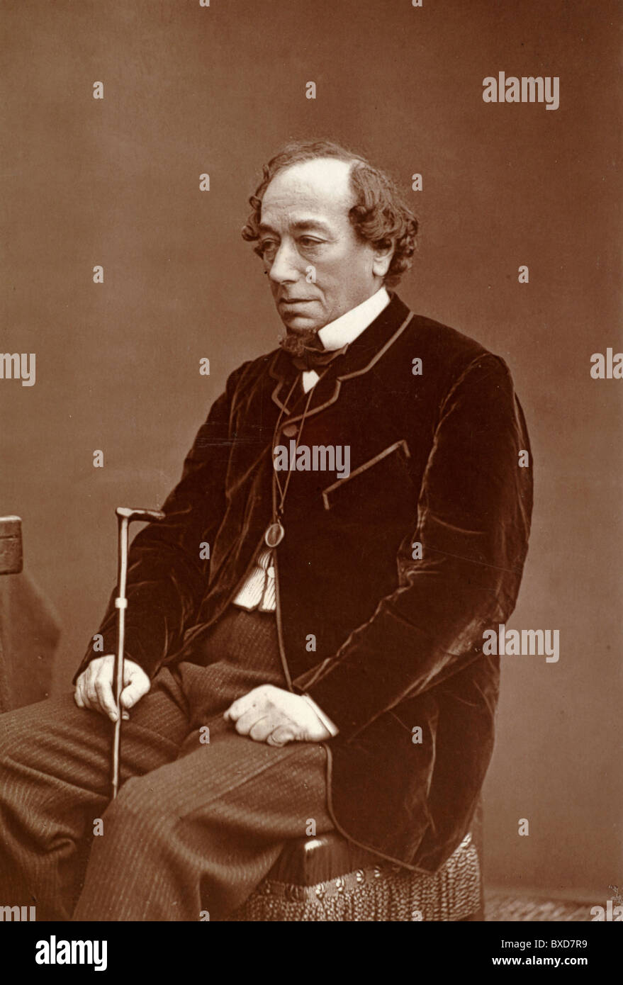 Portrait Benjamin Disraeli (1804-81) British Conservative Politician and Prime Minister Seated with Walking Stick. Vintage Albumen Print or Photograph c1870. Stock Photo