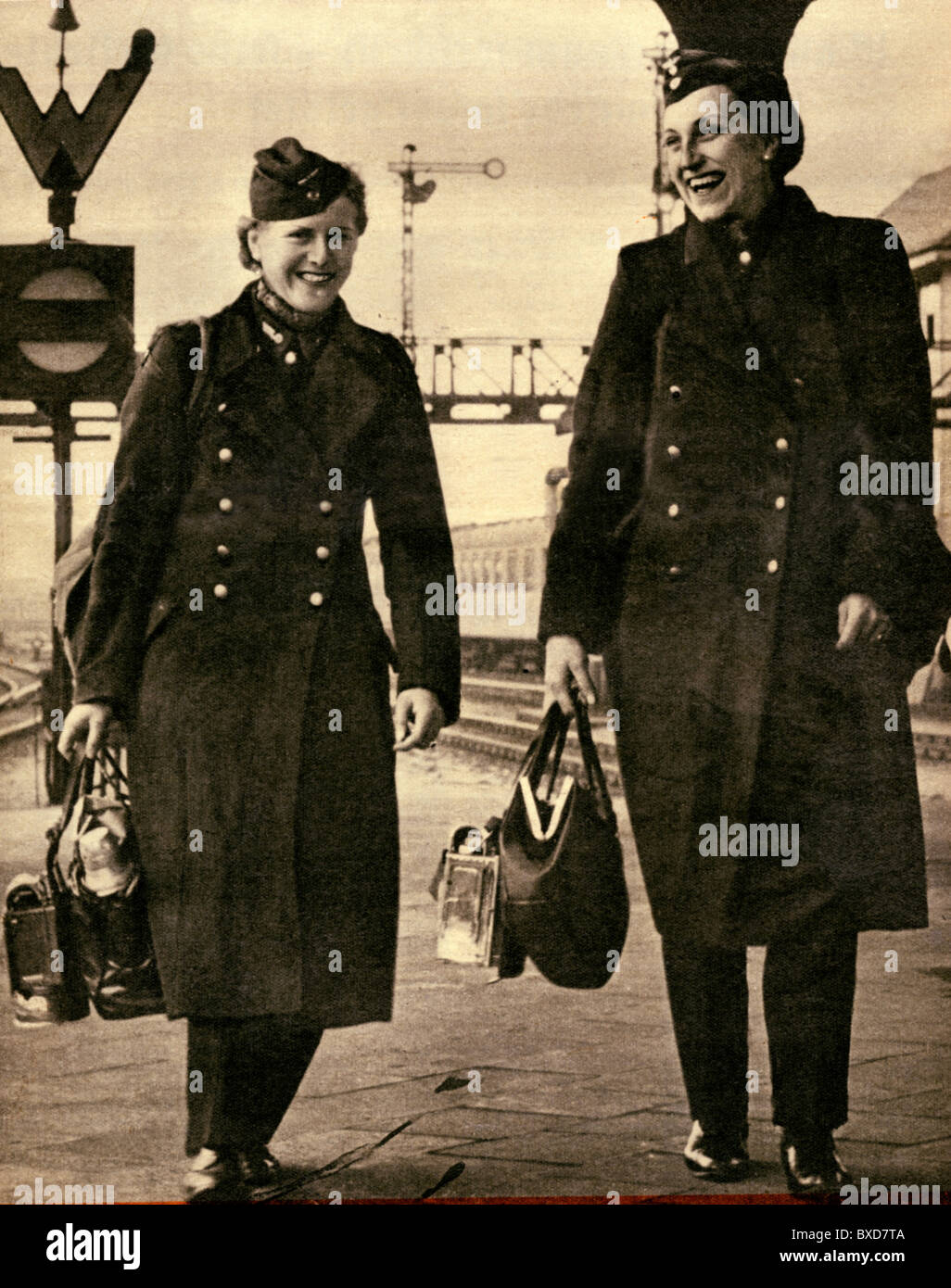 "people, women, 1940s, Germany, female train conductors returning from work, from ""Das Illustrierte Blatt"", 31.5.1941, Stock Photo"