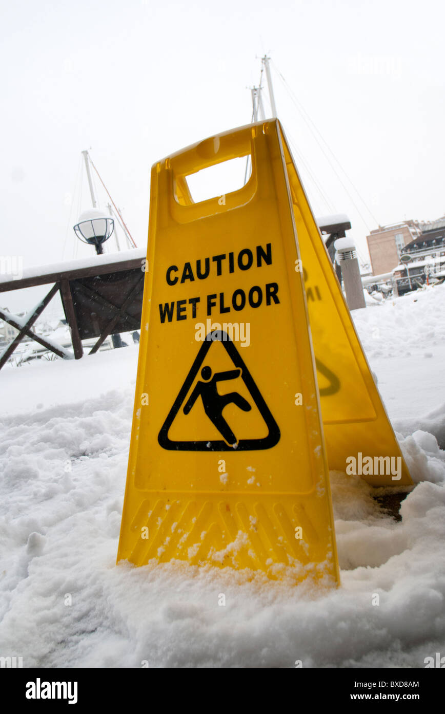 caution snowy surface could be slippery - Stock Image