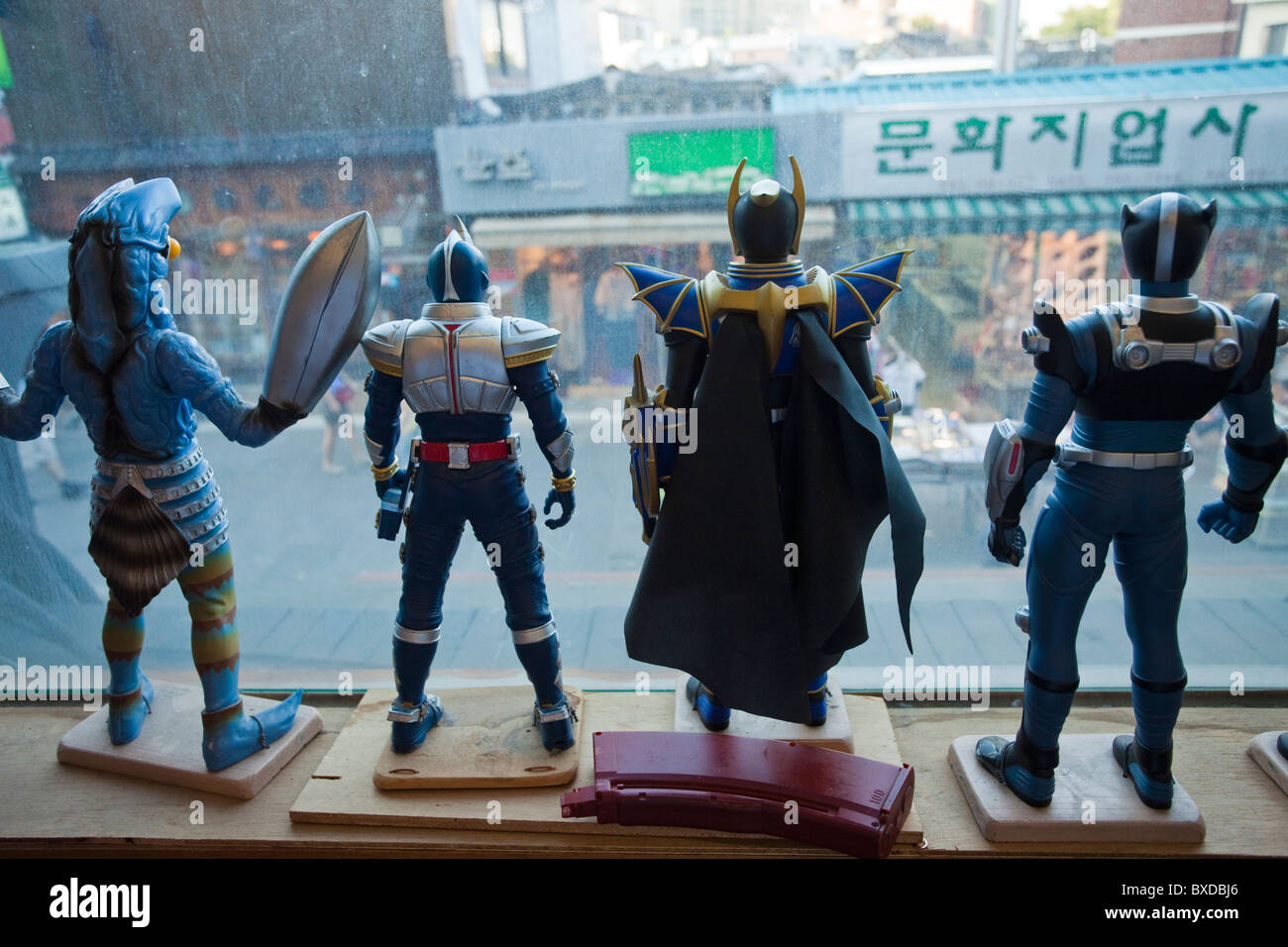 Toys looking out of the Toy  Museum window in Seoul, South Korea - Stock Image