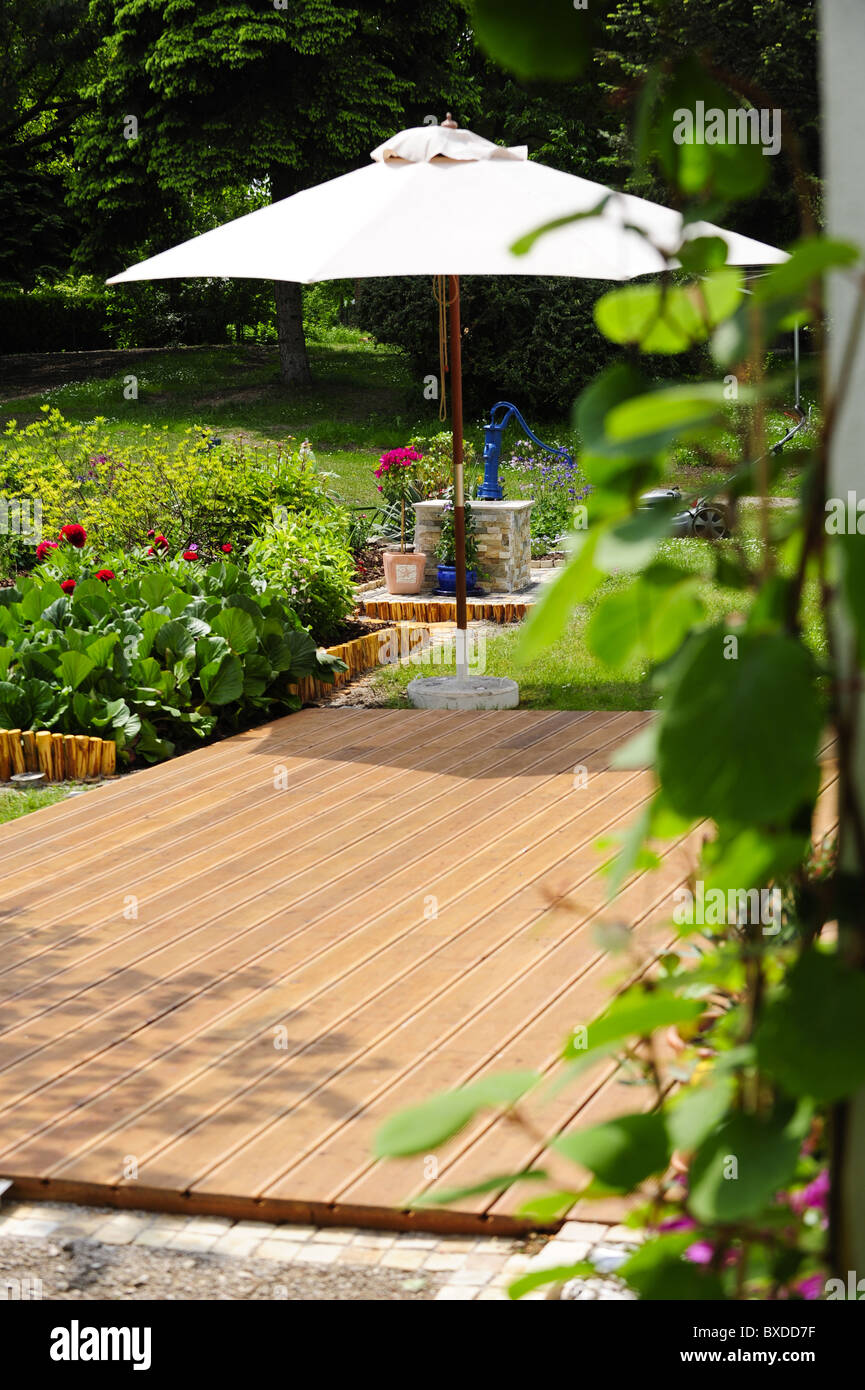 nature garden with wooden terrace - Stock Image