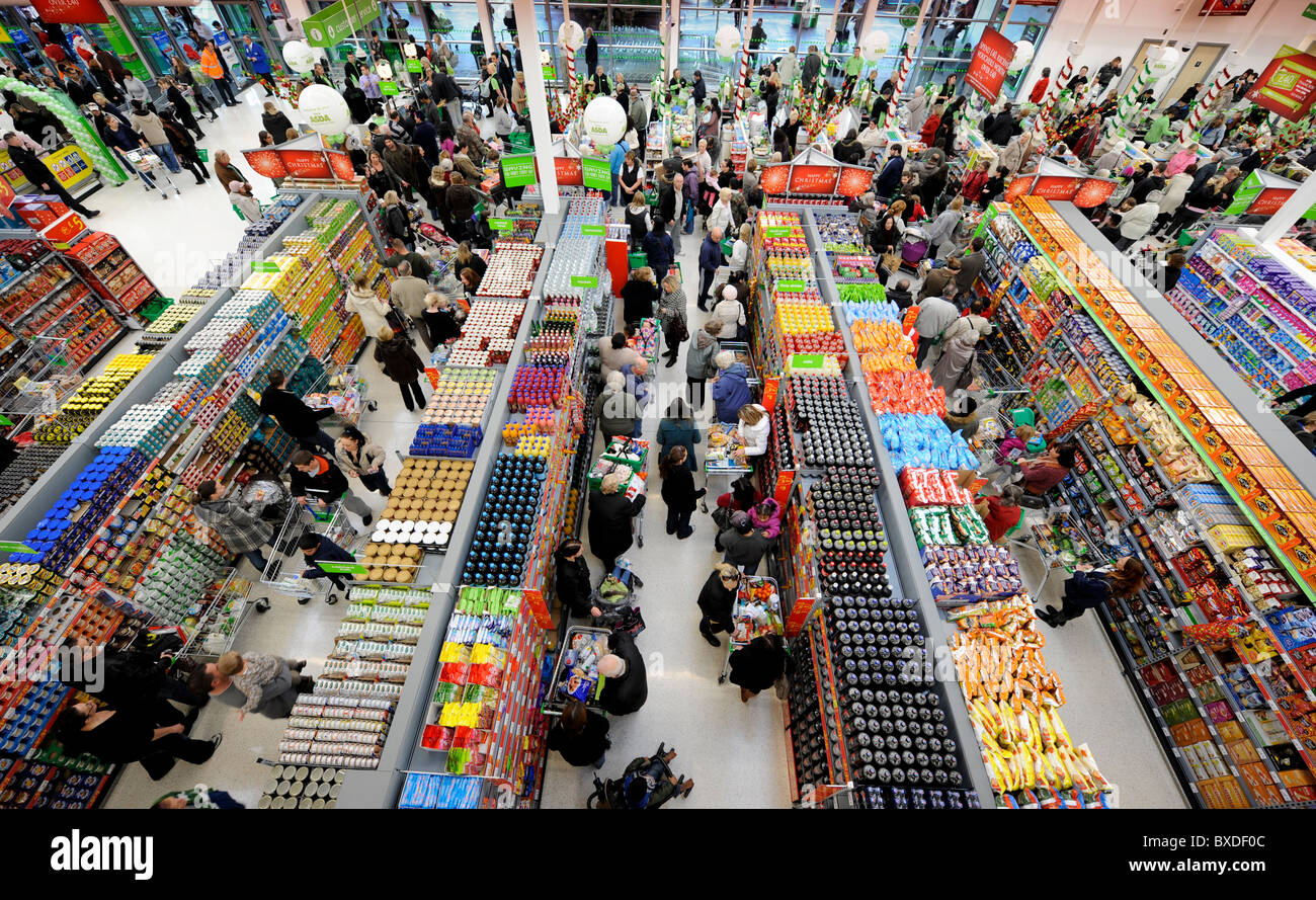 A busy supermarket store - customers queuing in aisles. - Stock Image