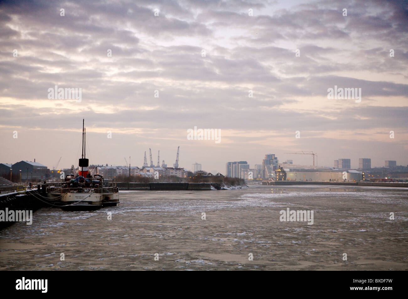 Waverly Paddle Steamer moored on frozen river Clyde in Glasgow. Stock Photo