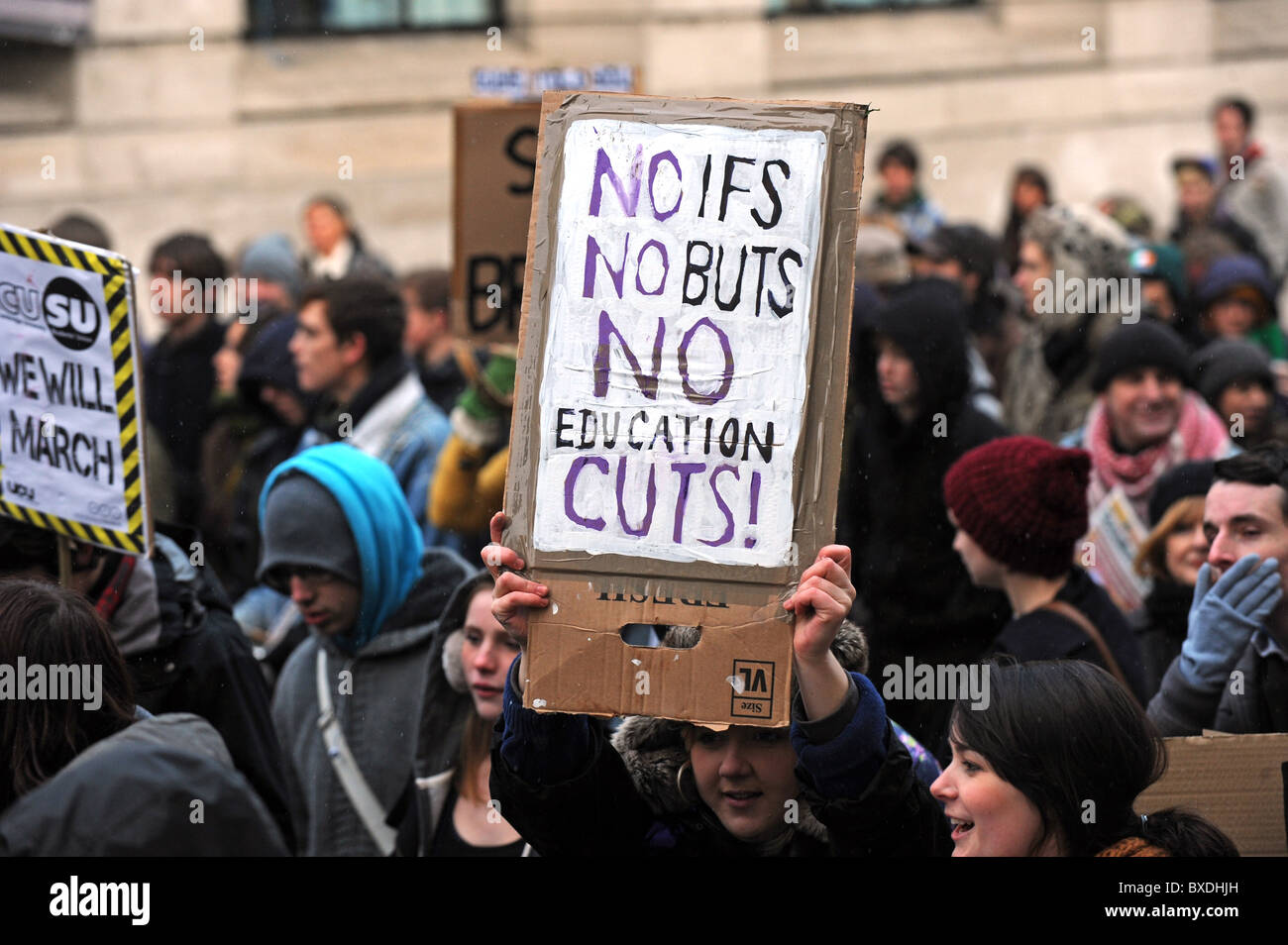 Mass demonstration in Brighton against government cuts to higher education funding - Protesters start marching with - Stock Image