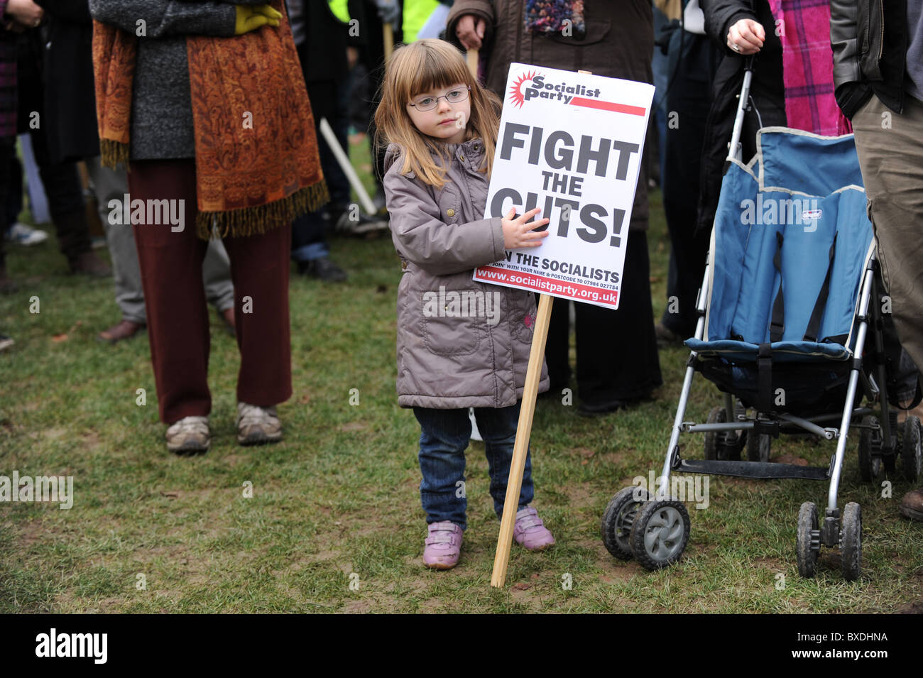 A young girl with a fight the cuts placard before a protest about the government's cuts to higher education - Stock Image