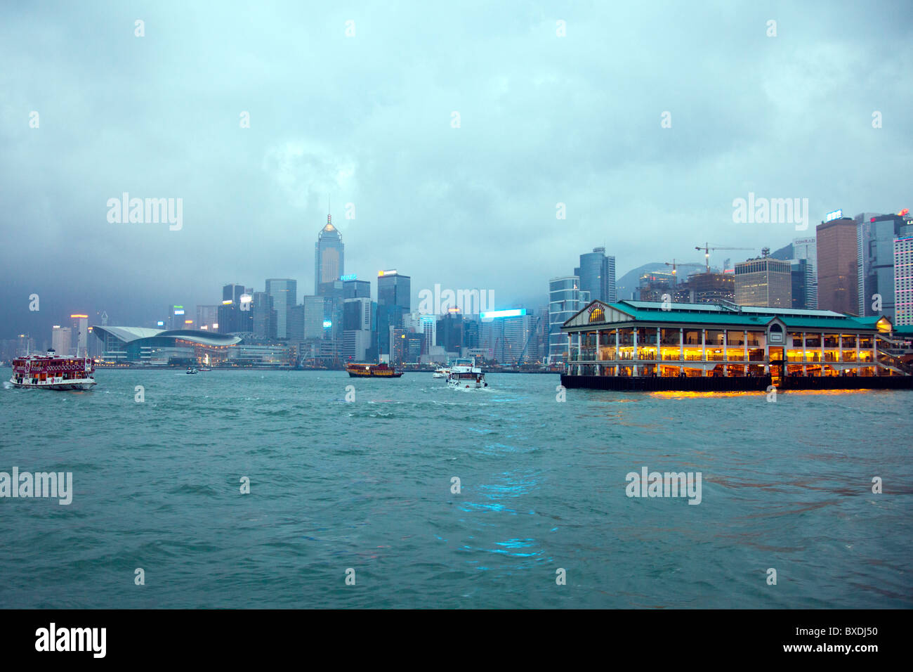 The amazing Hong Kong skyline as seen from Kowloon. The imposing structures include the mooring Stock Photo