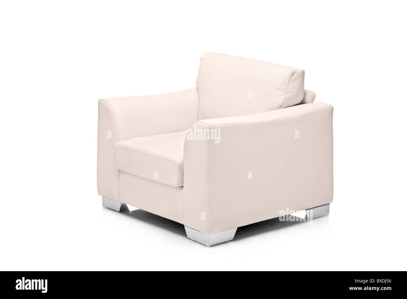 A studio shot of a leather white armchair - Stock Image
