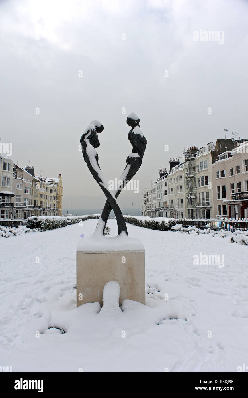 The Aids memorial statue by sculptor Romany Mark Bruce covered in snow in Kemp Town Brighton - Stock Image